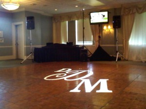 Monogram on Dance-floor & Plasma Screen next to DJ Johnny Only's table.