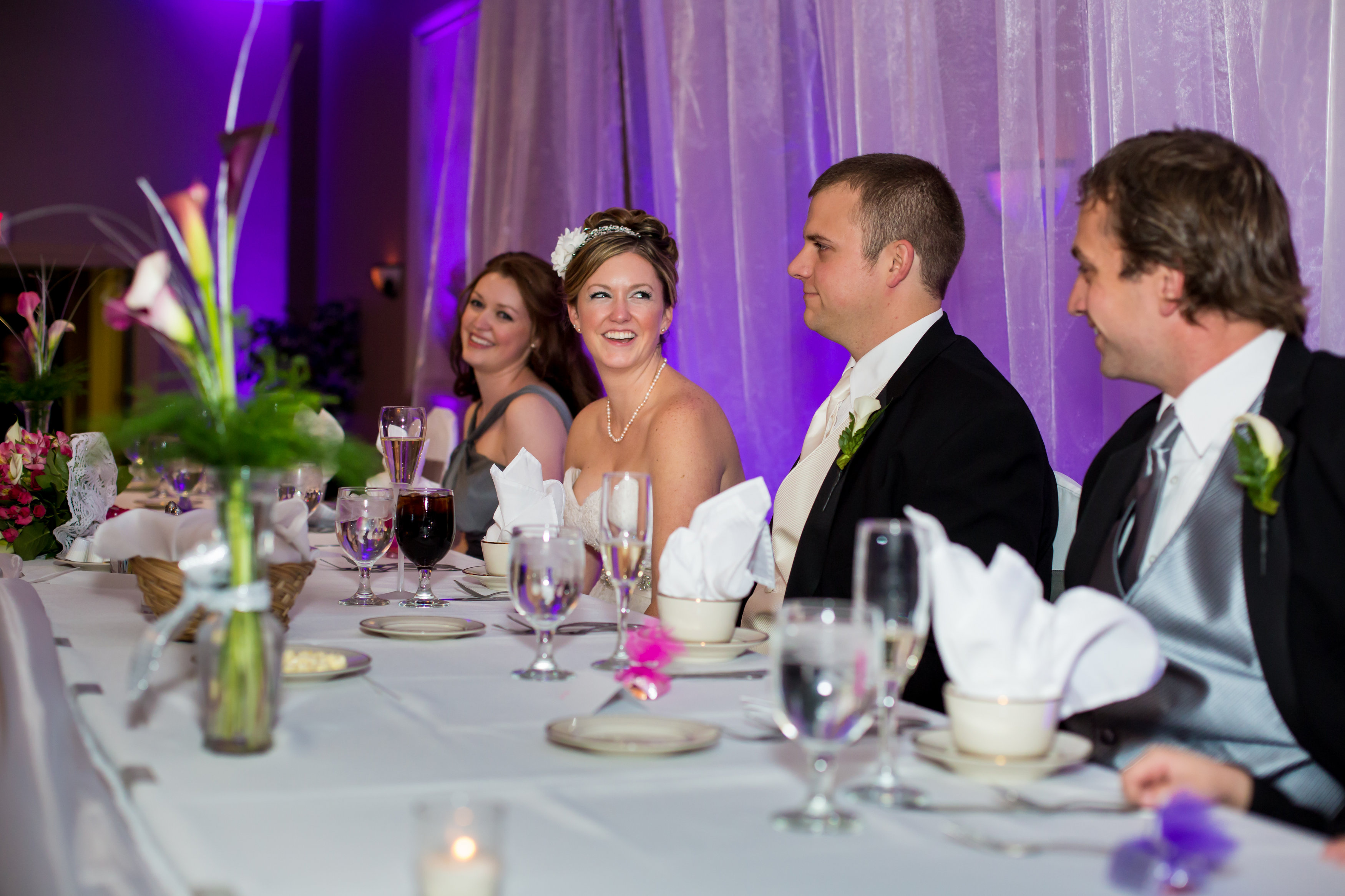 see how the uplighting brings out the colors on the head table beautiful color table uplighting